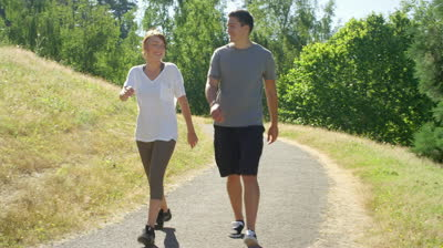 stock-footage-fit-and-healthy-young-couple-walks-through-the-park